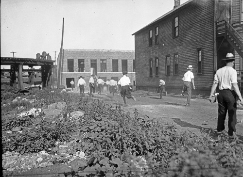 Mob running with bricks during Chicago Race Riots of 1919
